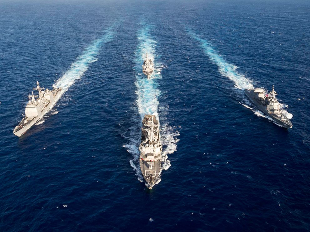 Guided-missile destroyer USS Mustin leads the guided-missile cruiser USS Antietam, USS Curtis Wilbur and the Japan Maritime Self-Defense Force ship JS Fuyuzuki in a formation for the completion of MultiSail 2018 on March 14, 2018, in the Philippine Sea.
