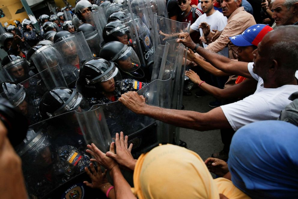 PHOTO: In this March 10, 2020, file photo, demonstrators scuffle with security forces during a protest in Caracas, Venezuela.