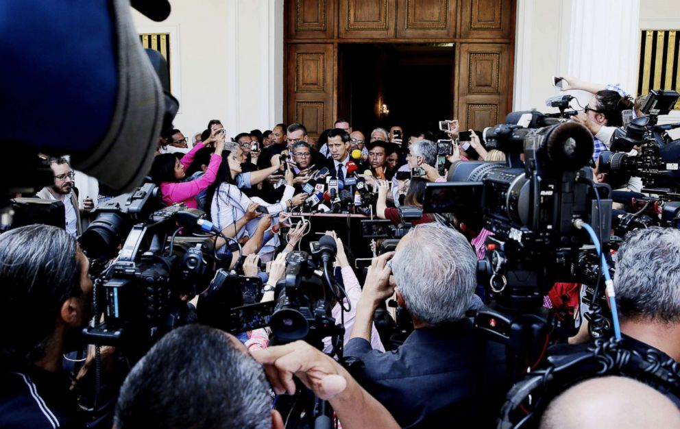 PHOTO: The president of the Venezuelan National Assembly Juan Guaido (C) speaks to the press as he arrives at the Parliament headquarters, in the Federal Legislative Palace, in Caracas, Venezuela, Jan. 29, 2019.