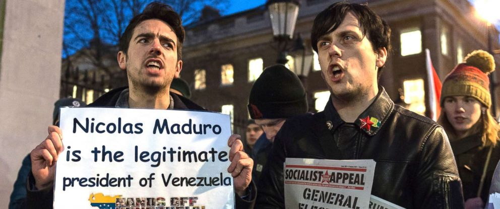 """PHOTO: Campaigners from """"Hands Off Venezuela"""" stage a protest outside Downing Street, London, on Jan 28, 2019."""