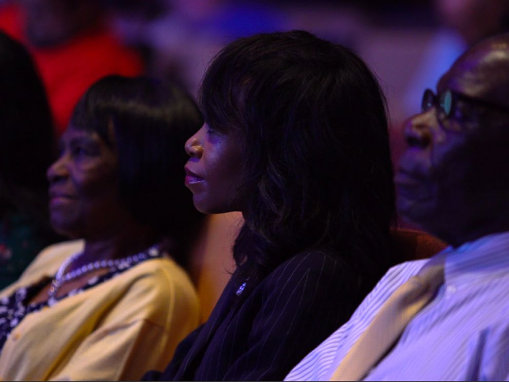 PHOTO: Vennia Francois sits with family and friends in church.