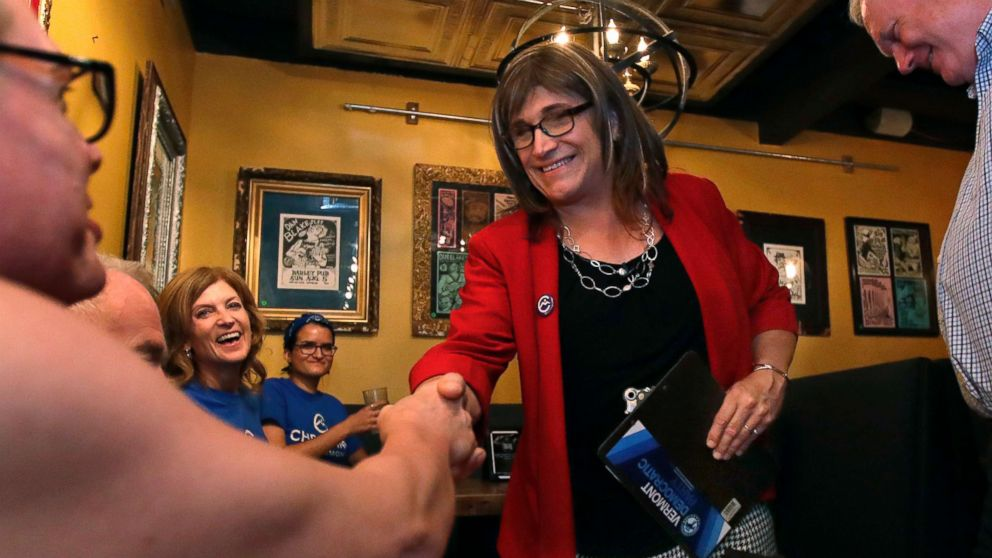Vermont Democratic gubernatorial candidate Christine Hallquist, holding clipboard, a transgender woman and former electric company executive, shakes hands with her supporters during her election night party in Burlington, Vt., on Aug. 14, 2018.