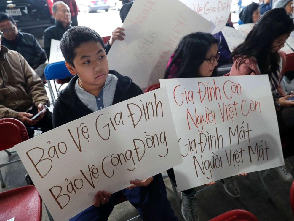 PHOTO: Bill Nguyen, 12, and Jade Nguyen, 9, hold signs at a rally protesting President Donald Trumps deportation policy to deport Vietnamese refugees, at the Mary Queen of Vietnam Church in New Orleans, Dec. 20, 2018.