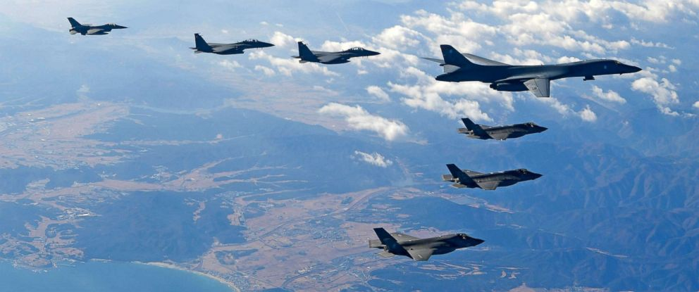 PHOTO: In this handout image provided by South Korean Defense Ministry, U.S. Air Force B-1B bomber, South Korea and U.S. fighter jets fly over the Korean Peninsula during the Vigilant air combat exercise (ACE) on December 6, 2017.