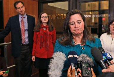 PHOTO: Democratic candidate Shelly Simonds, speaks to the press as her husband, Paul Danehy, left, and daughter, Georgia Danehy, listen after a drawing to determine the winner of a tied election at the Capitol in Richmond, Va., Jan. 4, 2018.