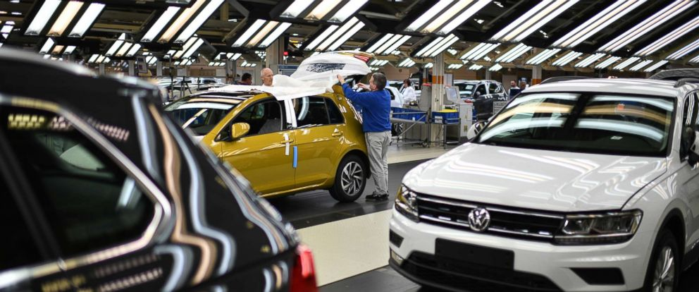 PHOTO: Workers assemble Volkswagen Golf cars at the Volkswagen factory on March 8, 2018 in Wolfsburg, Germany.