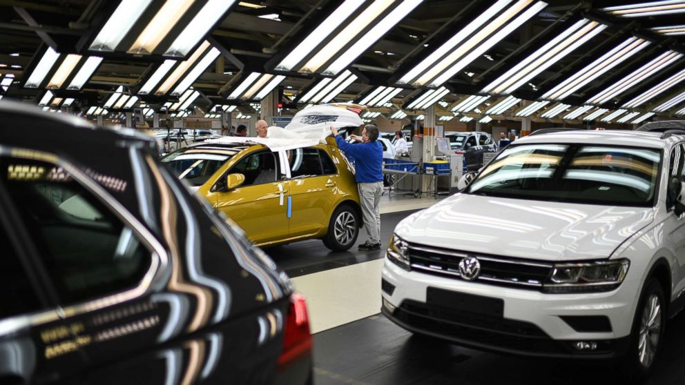 Workers assemble Volkswagen Golf cars at the Volkswagen factory on March 8, 2018 in Wolfsburg, Germany.