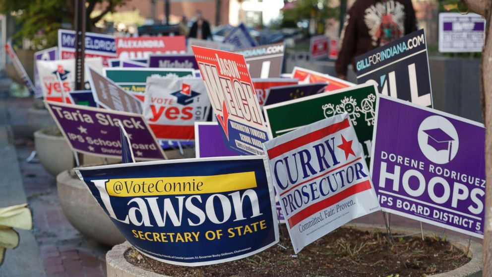 Signs for candidates in the upcoming Nov. 6 election fill flower beds outside an early voting center at the City County Building in Indianapolis, Oct. 23, 2018.