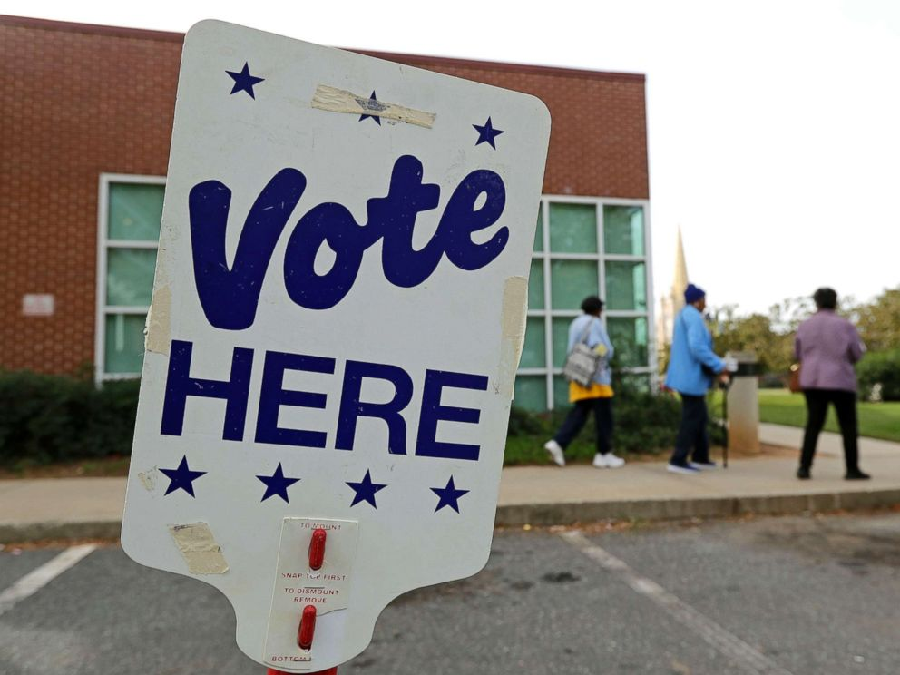 PHOTO: People arrive for early voting at a polling place in Charlotte, N.C., Oct. 23, 2018.