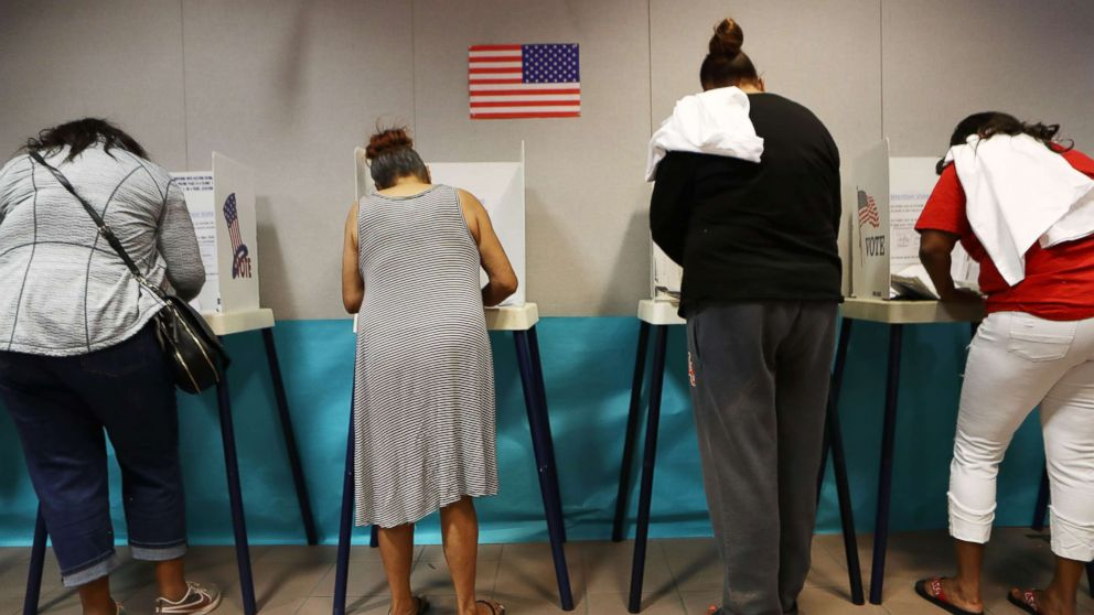 Voters fill out their ballots at a polling place to participate in early voting in California's 25th Congressional district, Nov. 4, 2018, in Lancaster, Calif.