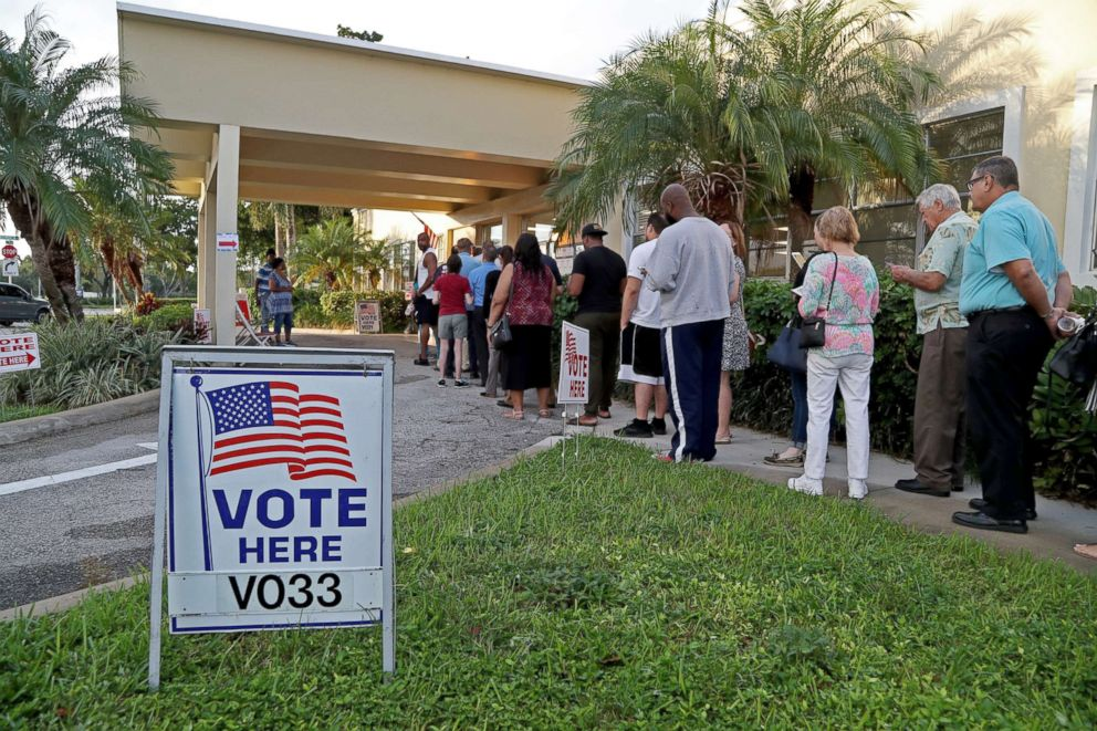 PHOTO: Voters in Hollywood, Fla., line up as the polls open at David Park Community Center, Nov. 6, 2018.