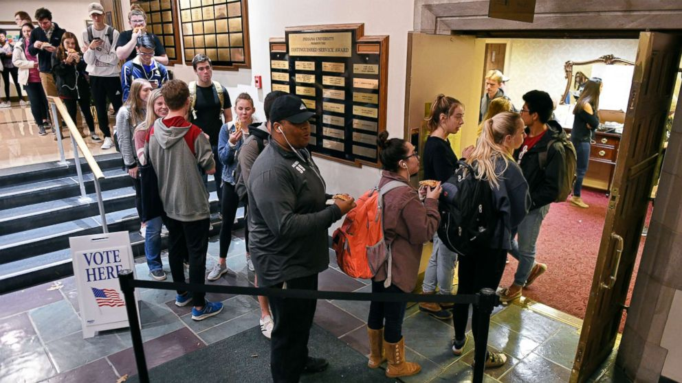 Voters wait in lines outside the University Club Room at the Indiana Memorial Union polling location in Bloomington, Ind., Nov. 6, 2018. Several polls ran short of ballots causing voters to wait in line until more ballots could be printed. Such was the case at this poll where voters were in line for close to two hours.