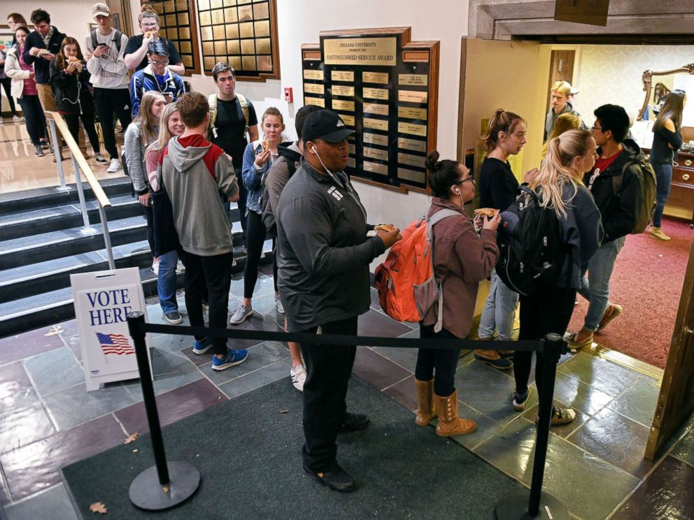PHOTO: Voters wait in lines outside the University Club Room at the Indiana Memorial Union polling location in Bloomington, Ind., Nov. 6, 2018.