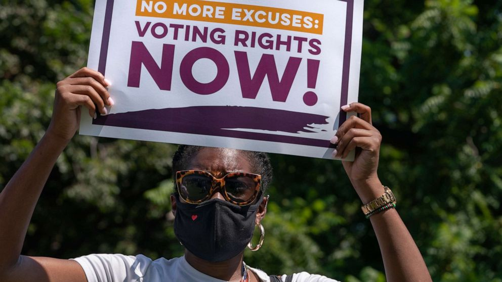 PHOTO: LaQuita Howard of Washington, with the League of Women Voters, attends a rally for voting rights, Aug. 24, 2021, near the White House in Washington.
