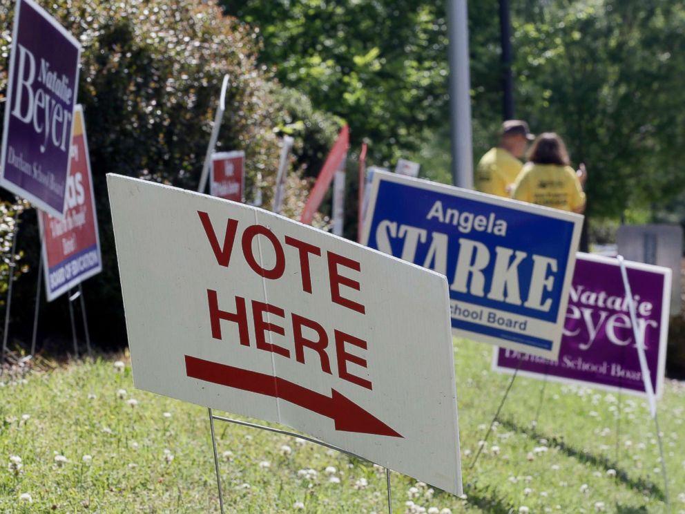 PHOTO: Voting signs line the sidewalk in Durham, N.C., May 8, 2018.