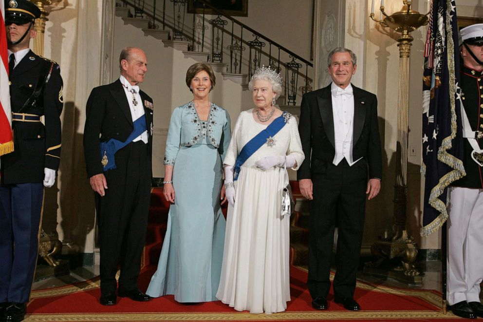 PHOTO: Queen Elizabeth II (2R), her husband Prince Philip (L), President George W. Bush (R) and First Lady Laura Bush (2L) pose for a photo in the Grand Foyer of the White House prior to a State Dinner, May 7, 2006.