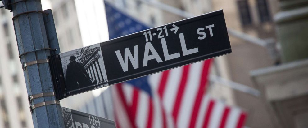 PHOTO: A Wall Street street sign is displayed in front of the New York Stock Exchange in New York, April 18, 2016.
