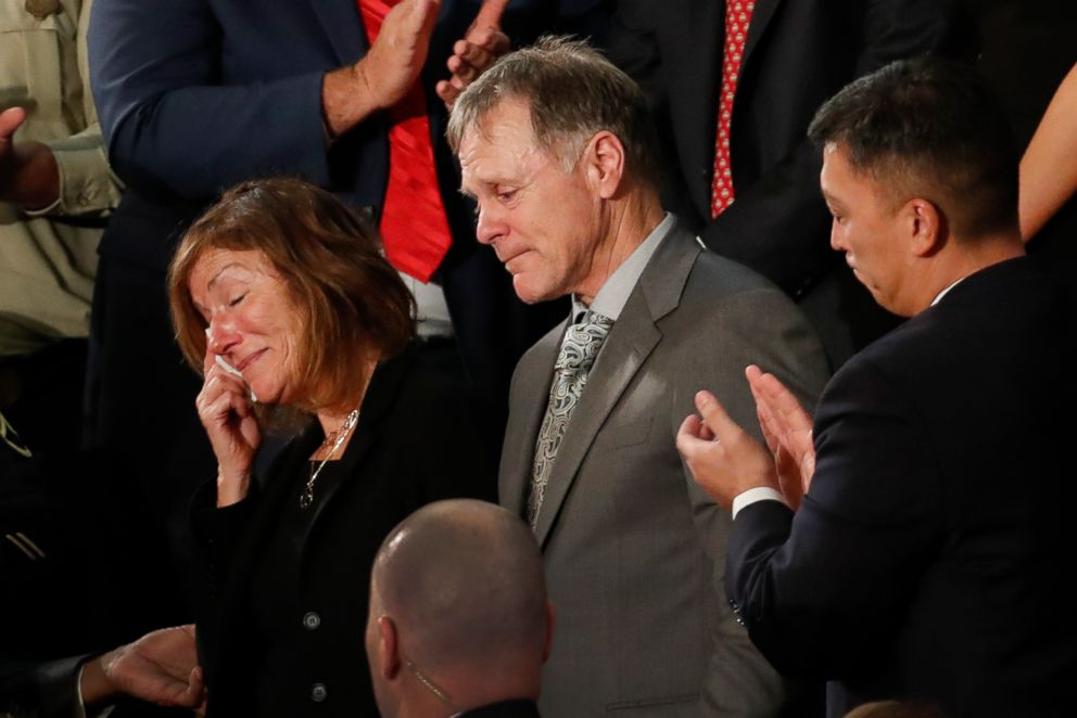 The parents of Otto Warmbier react to a standing ovation during State of the Union address to a joint session of Congress on Capitol Hill in Washington, D.C., Jan. 30, 2018.