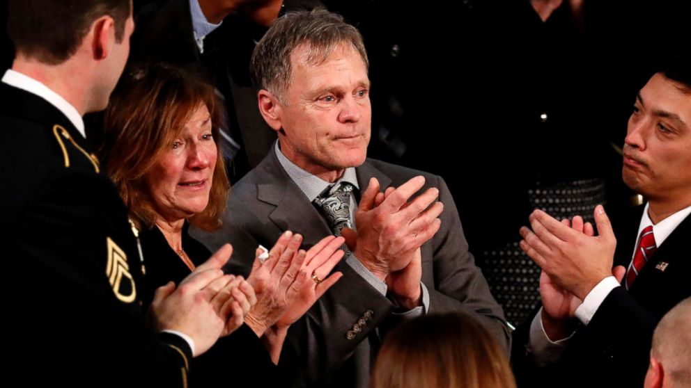 American student Otto Warmbier's parents Fred and Cindy Warmbier applaud as President Donald Trump talks about the death of their son Otto after his arrest in North Korea during the State of the Union address to a joint session of the U.S. Congress on Capitol Hill in Washington, D.C., Jan. 30, 2018.