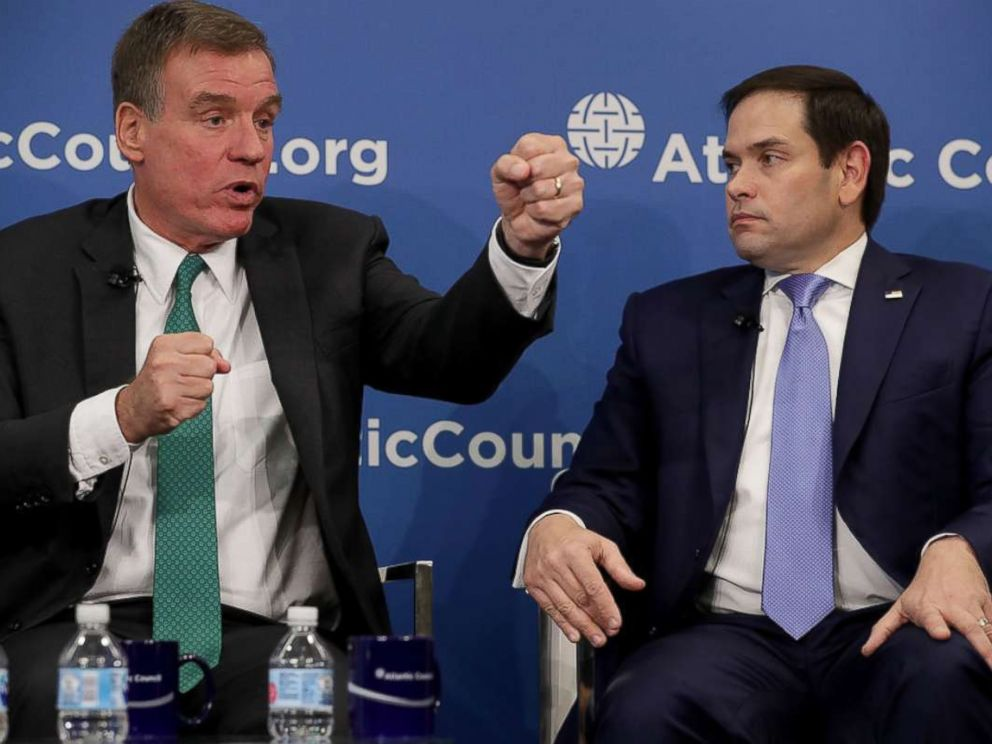 PHOTO: Sen. Mark Warner (D-VA) and Sen. Marco Rubio (R-FL), both members of the Senate Intelligence Committee, participate in a discussion at the Atlantic Council July 16, 2018 in Washington.