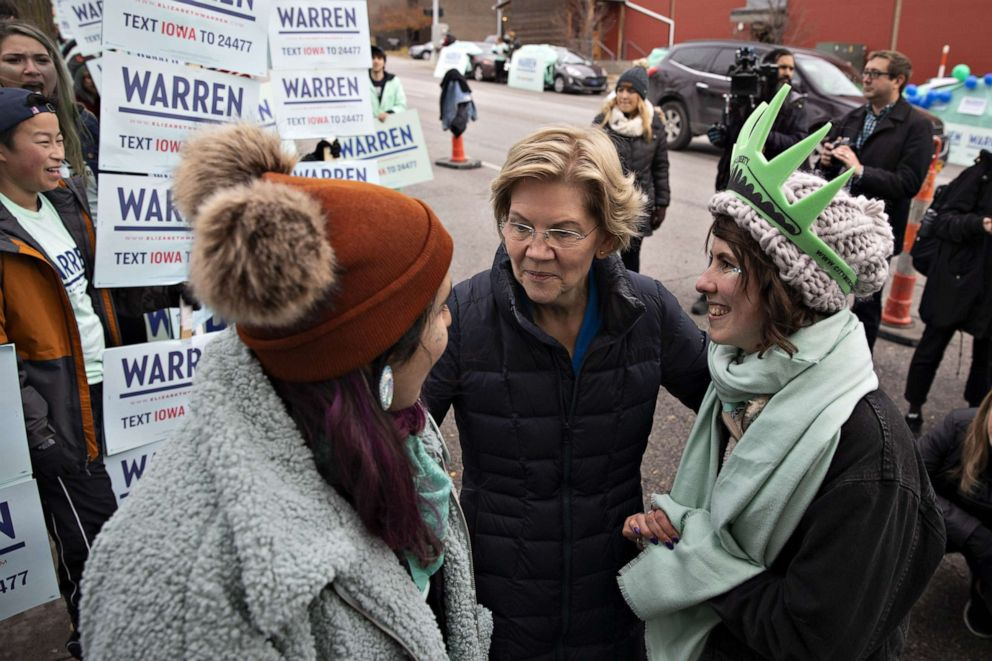 PHOTO: Senator Elizabeth Warren, a Democrat from Massachusetts and 2020 presidential candidate, center, greets supporters outside Wells Fargo Arena ahead of the Iowa Democratic Party Liberty & Justice Dinner in Des Moines, Iowa, U.S.