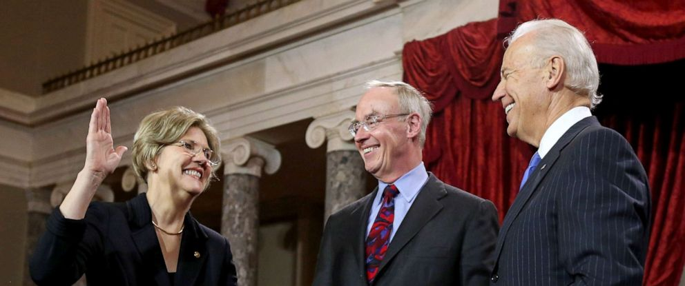PHOTO: Elizabeth Warren participates in a reenacted swearing-in with her husband Bruce Mann and U.S. Vice President Joe Biden in the Old Senate Chamber at the U.S. Capitol, Jan. 3, 2013, in Washington, DC.