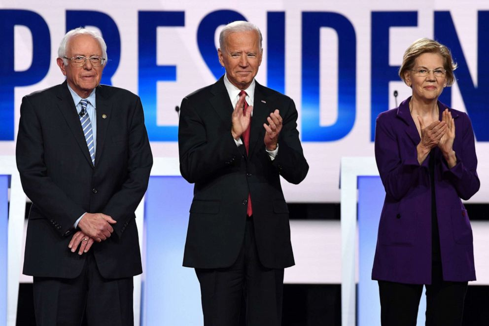 PHOTO: In this file photo taken on Oct. 15, 2019, Democratic presidential hopefuls Senator Bernie Sanders, former US Vice President Joe Biden and Senator Elizabeth Warren arrive onstage for the Democratic primary debate at in Westerville, Ohio.