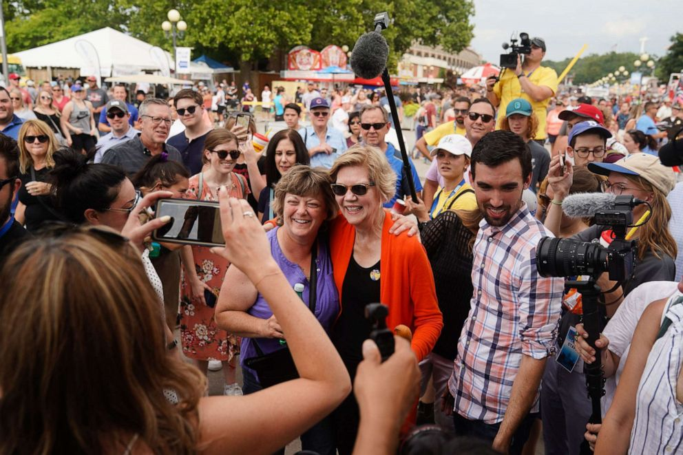 PHOTO: U.S. Senator and Democratic presidential candidate Elizabeth Warren takes a photograph with a supporter at the Iowa State Fair in Des Moines, Iowa, USA, August 10, 2019.