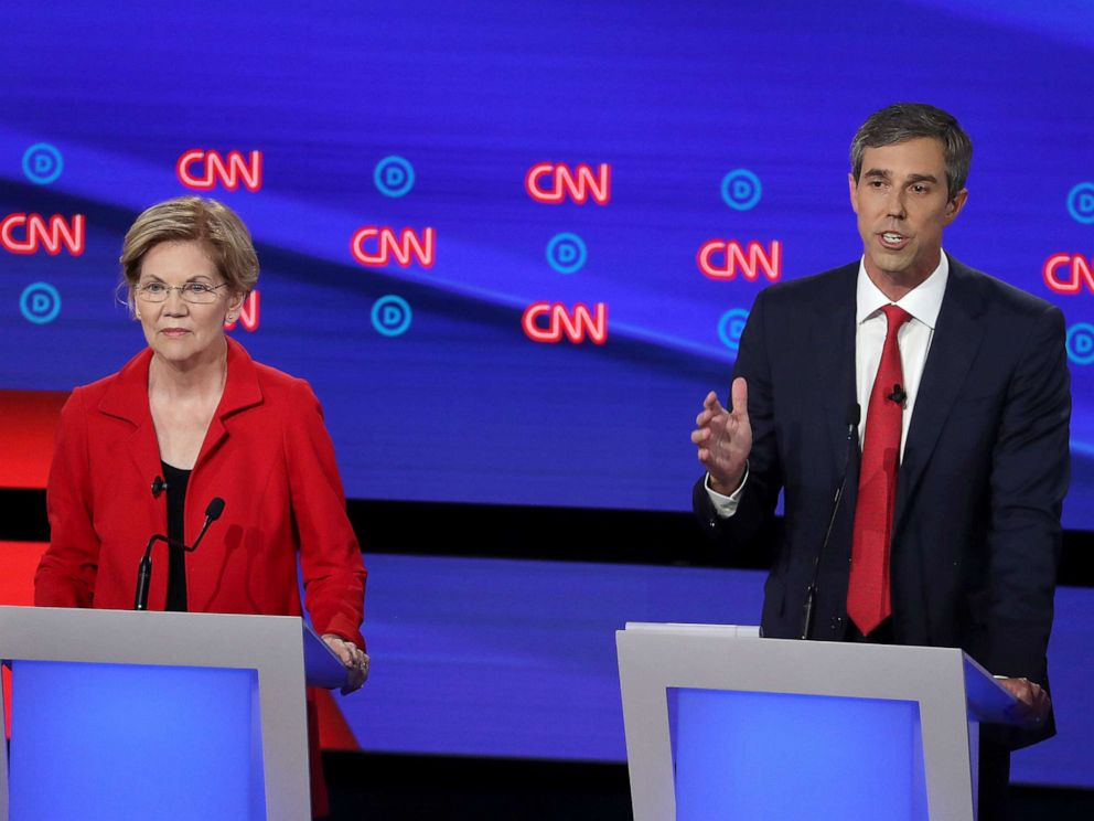 PHOTO: Democratic presidential candidate former Texas congressman Beto ORourke, right, speaks while Sen. Elizabeth Warren listens during the Democratic Presidential Debate at the Fox Theatre July 30, 2019 in Detroit.