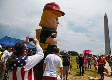 PHOTO: People take photos of a statue of President Donald Trump tweeting on a toilet, at the National Mall ahead of the, Salute to America Fourth of July event in Washington, July 4, 2019.