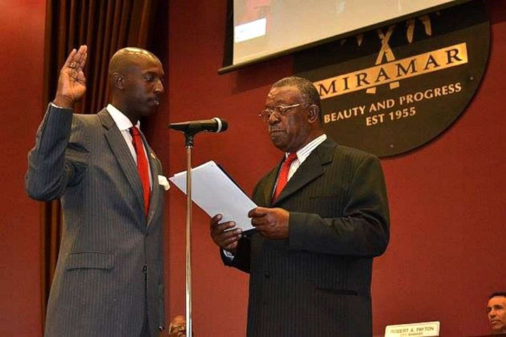 PHOTO: Mayor Wayne Messam pictured with his late father, Hubert Messam, in 2011 as he issued Wayne the Oath of Office to serve on the Miramar City Commission.