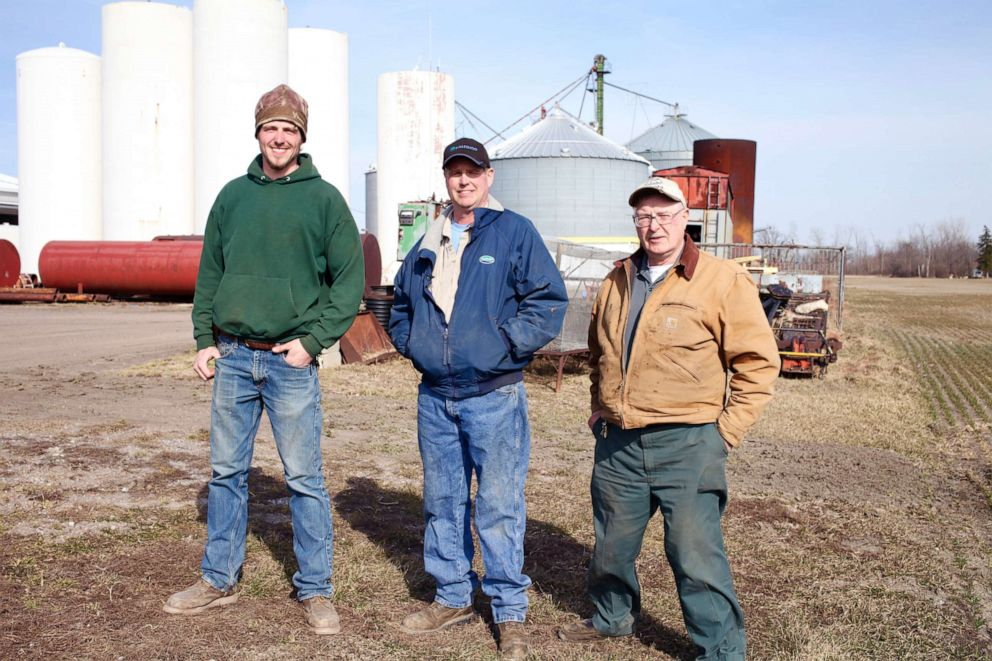 Third generation farmer Donald Wendland Jr. in  Saginaw, Michigan photographed with his father and son.