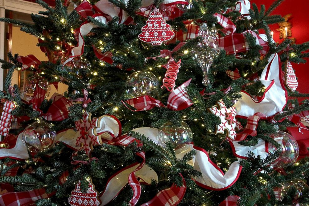 photo ornaments are hung on a christmas tree in the red room at the white - Christmas Holiday Decorations