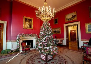 photo christmas decor adorns red room of the white house in washington nov