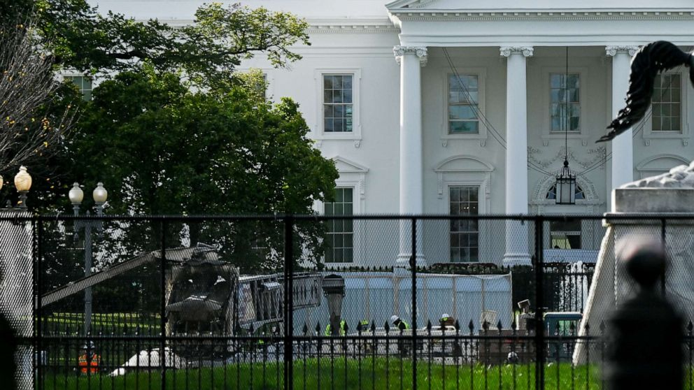 'Non-scalable' fencing erected around White House, stores boarded up in anticipation of election protests