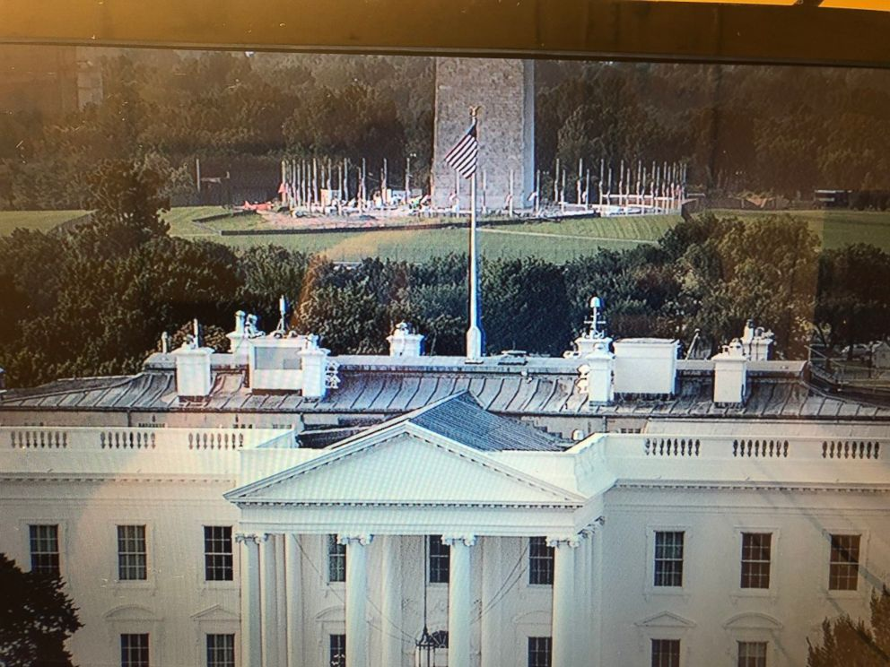 PHOTO: Camera shot facing south over the White House - you can see the flag at the WH at full staff while the flags surrounding the Washington Monument are lowered as of 5:13 am on Aug, 27, 2018.