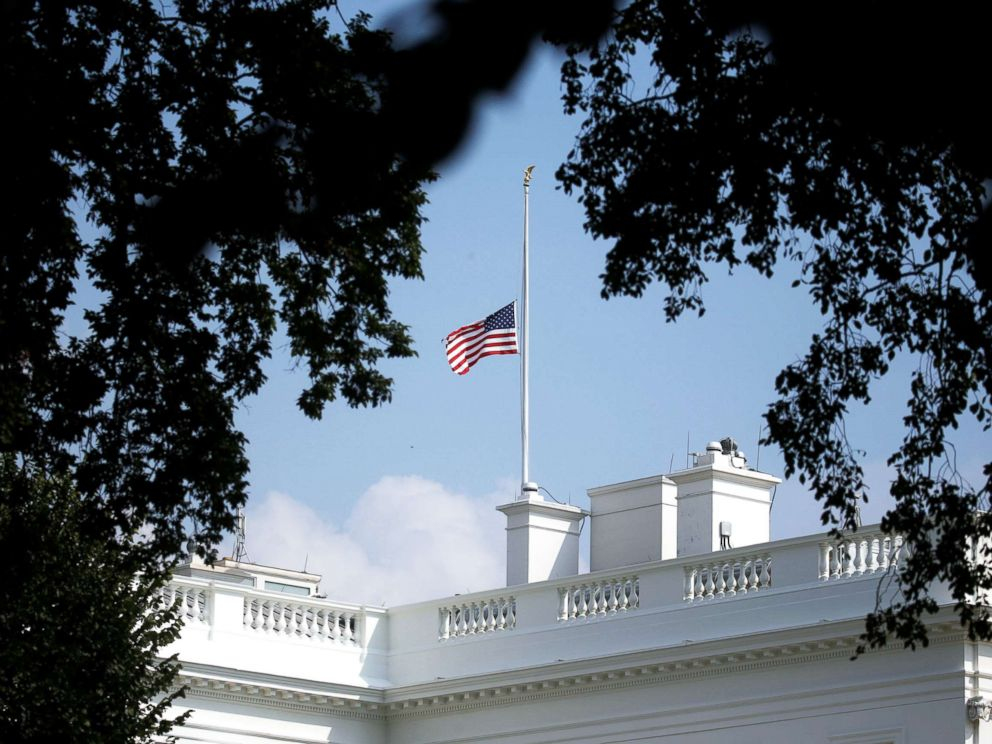 PHOTO: The White House flag is seen after being returned to half-staff in honor of Senator John McCain at the White House, Aug. 26, 2018.