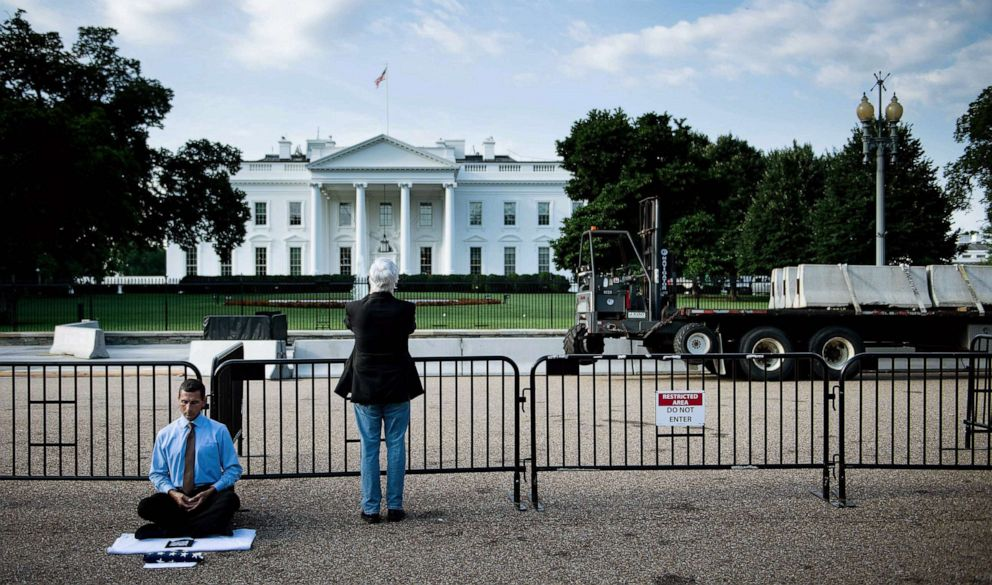 PHOTO: Preparations are made to modify the fence surrounding the White House, July 12, 2019, in Washington, D.C.