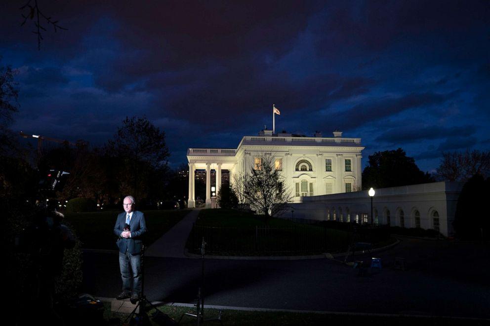 PHOTO: The media gathers outside the White House at dusk, Nov. 17, 2020 in Washington, DC.