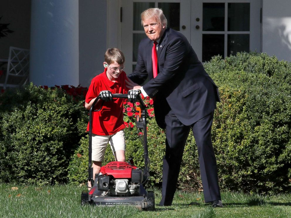 PHOTO: Frank Giaccio, 11, of Falls Church, Va., left, is encouraged by President Donald Trump, Sept. 15, 2017, while he mowed the lawn in the Rose Garden at the White House in Washington.