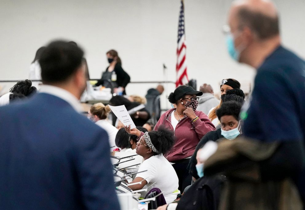 PHOTO:Election challengers observe as ballots are counted at the central counting board in Detroit, Nov. 4, 2020.