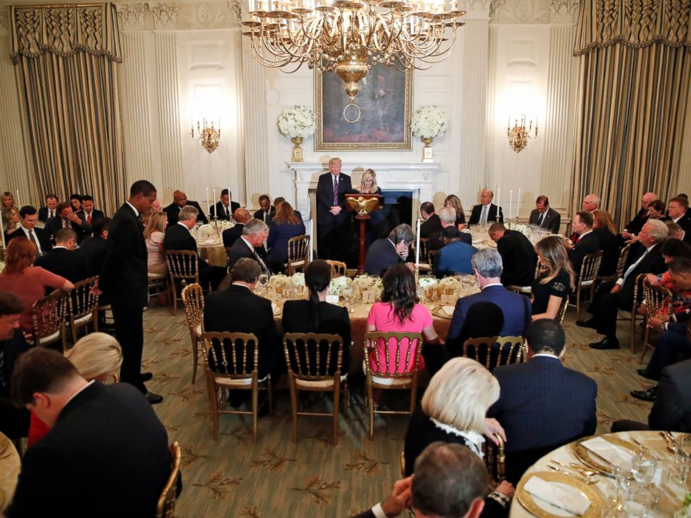 PHOTO: President Donald Trump bows his head in prayer as pastor Paula White leads the room in prayer during a dinner for evangelical leaders in the State Dining Room of the White House, Monday, Aug. 27, 2018, in Washington.