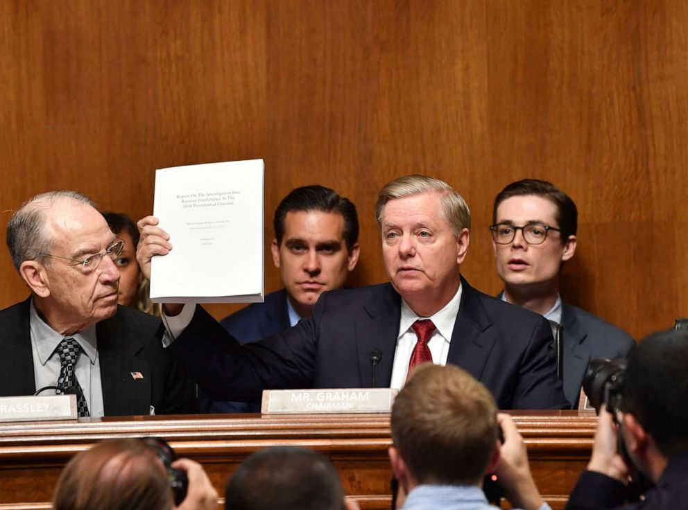 PHOTO: Sen. Lindsey Graham holds the Mueller report as U.S. Attorney General William Barr prepares to testify before the Senate Judiciary Committee in Washington, May 1, 2019.