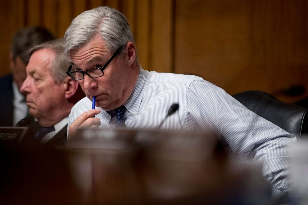 PHOTO: Sen. Sheldon Whitehouse listens as Attorney General William Barr testifies during a Senate Judiciary Committee hearing on Capitol Hill in Washington, May 1, 2019.