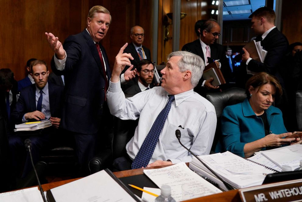 PHOTO: Sen. Lindsay Graham speaks with Sen. Sheldon Whitehouse at a Senate Judiciary Committee hearing where Attorney General William Barr testified on Capitol Hill in Washington, May 1, 2019.