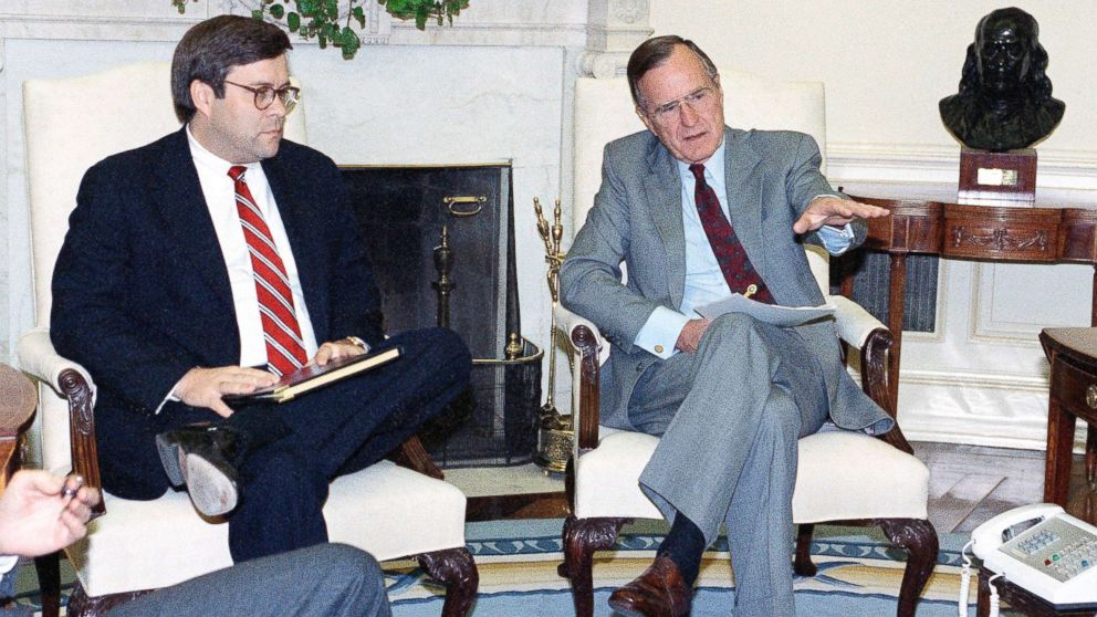 President George H. Bush gestures while talking to Attorney General William Barr in the Oval Office of the White House, May 4, 1992 in Washington.