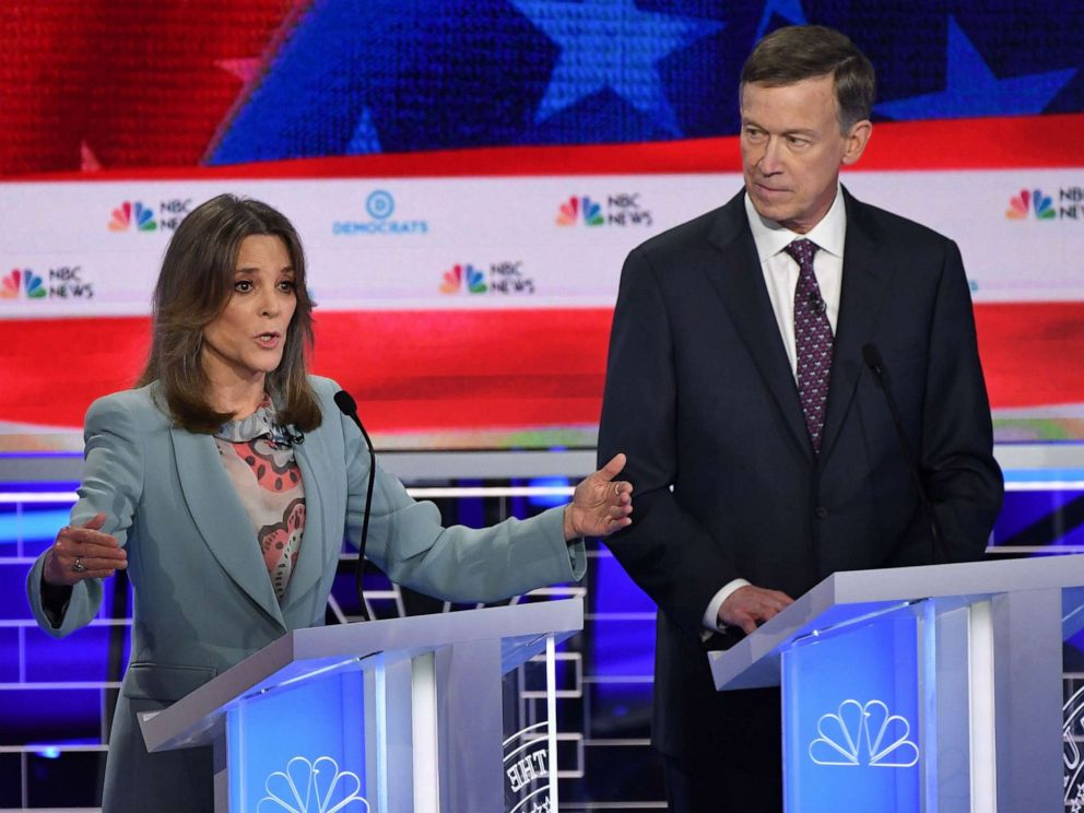 PHOTO: Marianne Williamson and John Hickenlooper participate in the second night of the first 2020 democratic presidential debate at the Adrienne Arsht Center for the Performing Arts in Miami, June 27, 2019.