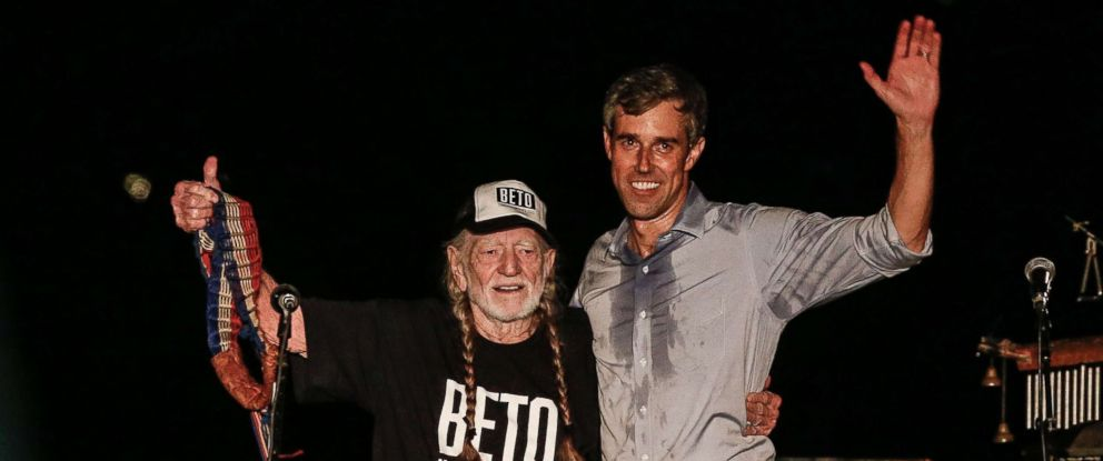 PHOTO: Beto ORourke, right, along with country music legend Willie Nelson, left, wave to supporters at a Turn Out For Texas Rally in Austin, Texas, Sept. 29, 2018.
