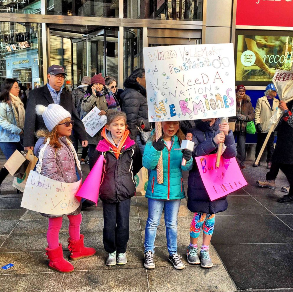 PHOTO: Cheryl Lu-Lien Tan posted this photo to her Facebook, Jan. 20, 2018, showing young girls at the Womens March in New York City holding a sign that says, When Voldemort is president we need a nation of Hermiones.