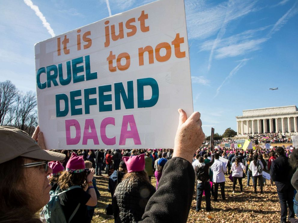 PHOTO: A demonstrator holds a sign saying It is just cruel to not defend DACA as thousands of activists gathered on the National Mall and marched to the White House for the 2018 Womens March on Washington D.C., Jan. 20, 2018.